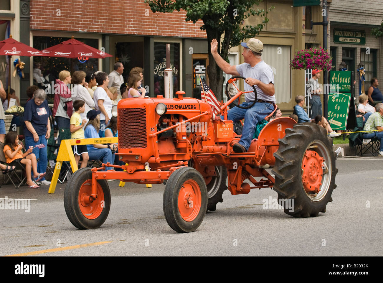 Man Driving Vintage 1955 Allis Chalmers Tractor In Independence Day Parade Corydon Indiana Stock Image