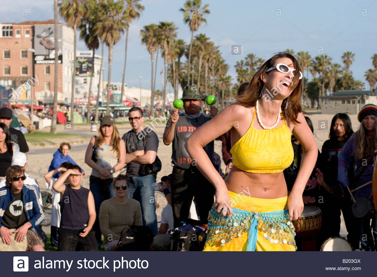 young woman in bikini dancing in drum circle venice beach. Black Bedroom Furniture Sets. Home Design Ideas