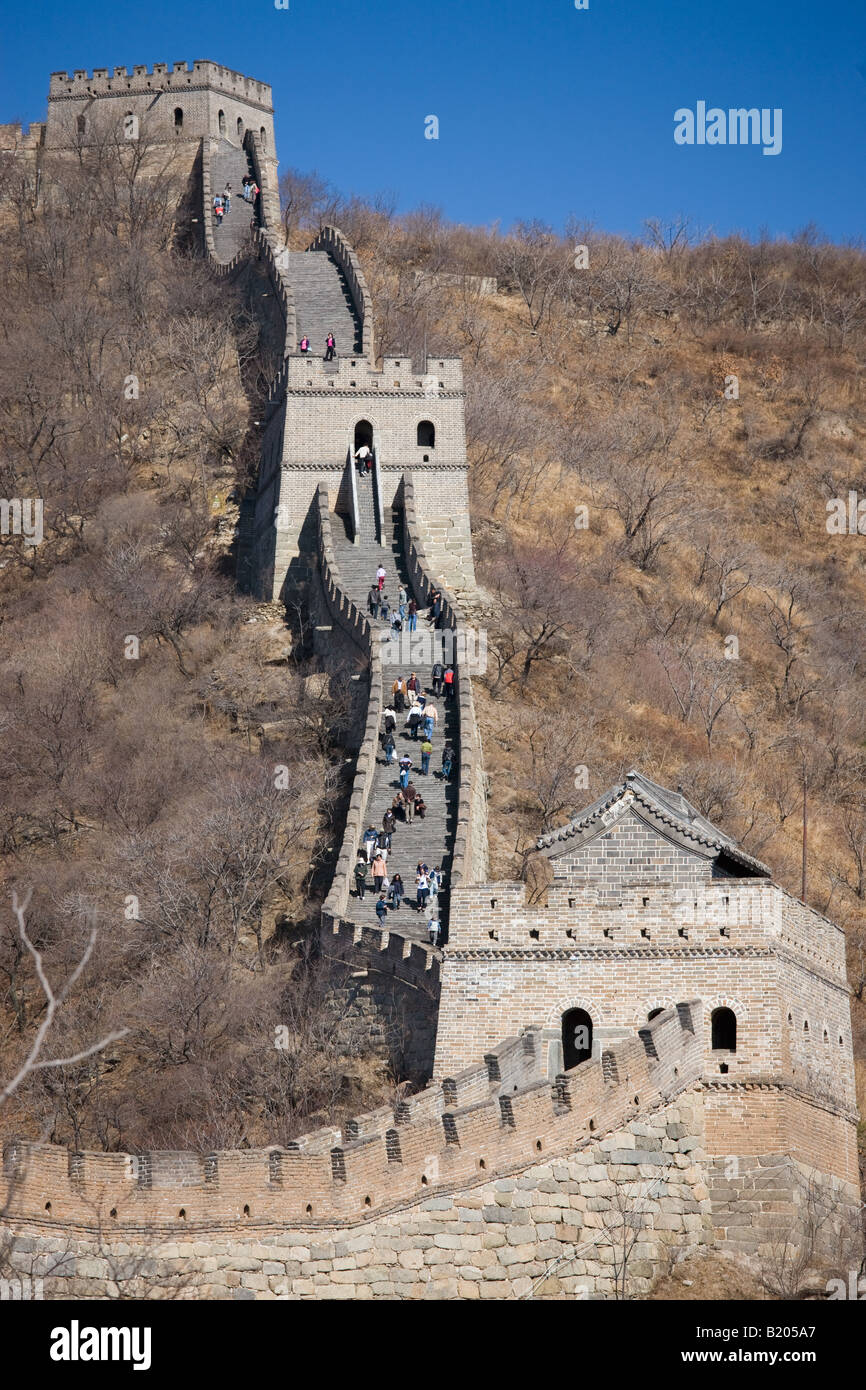 The ancient Great Wall of China snaking through mountains at Mutianyu north of Beijing formerly Peking - Stock Image