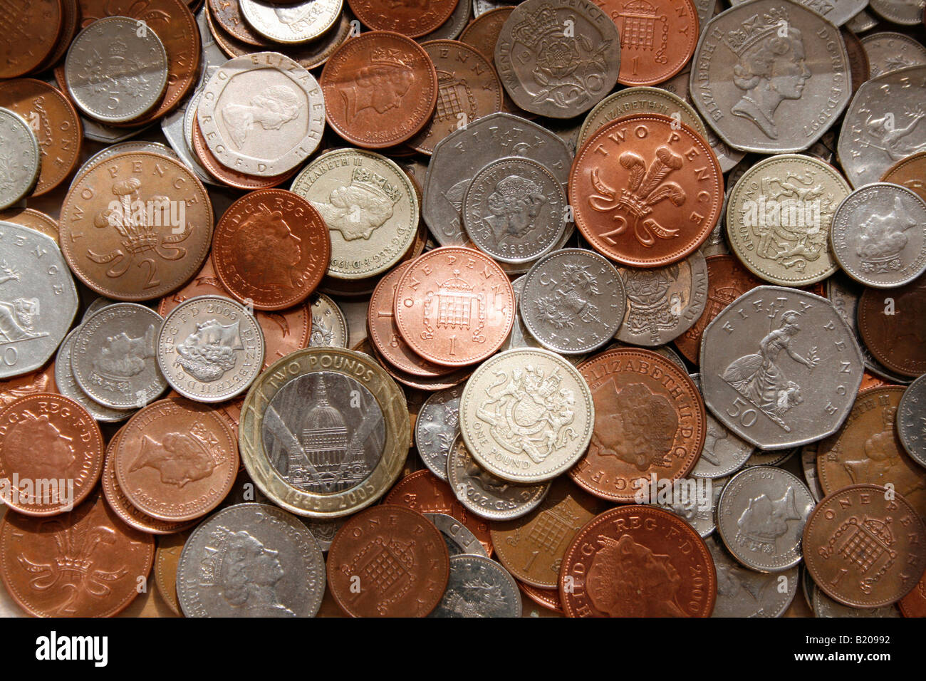 All current UK coins in common usage are laid out, copper coins, silver coins, £1 and £2 coins. - Stock Image