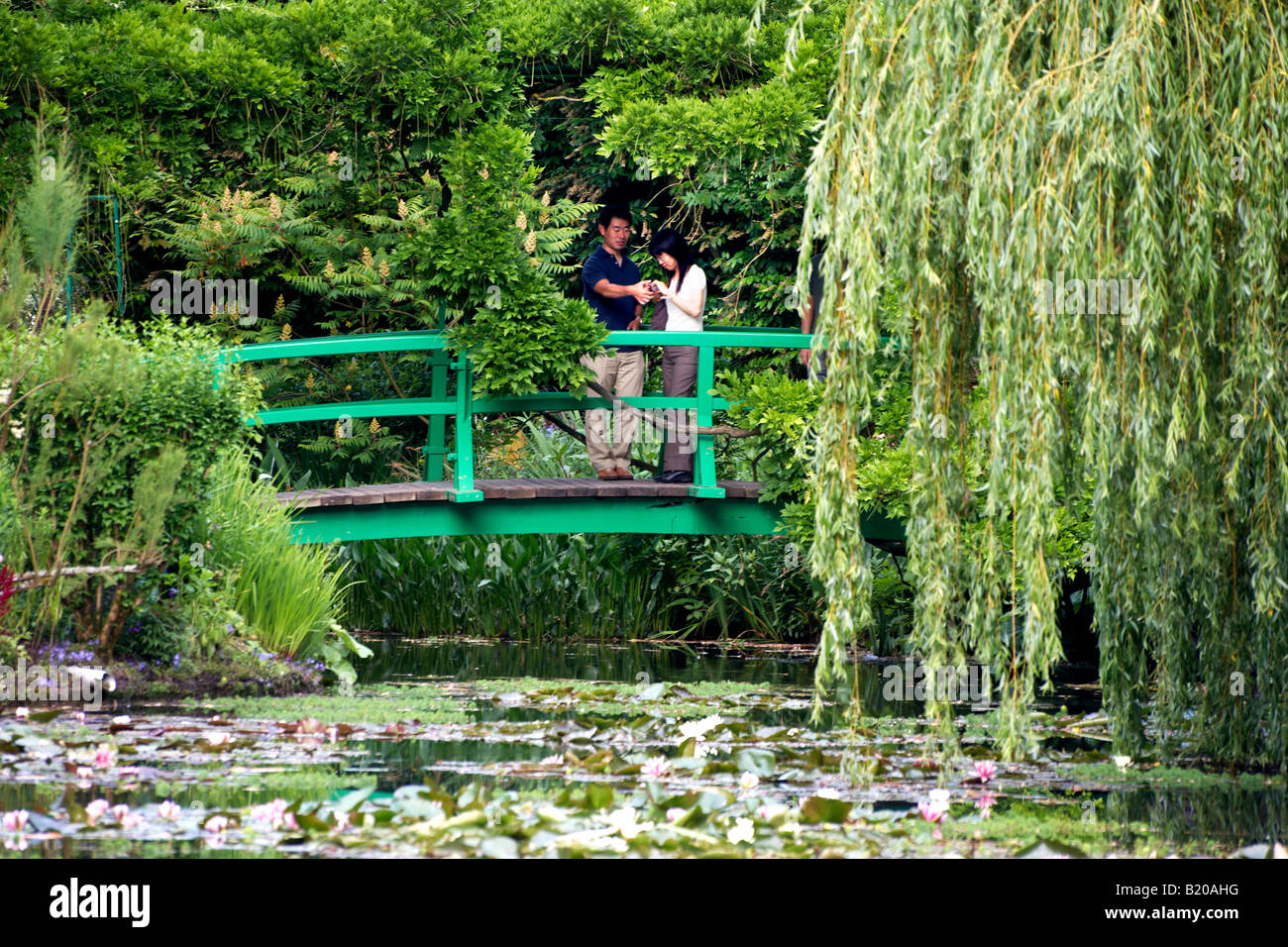 Couple On Japanese Bridge Monetu0027s Garden Giverny Near Paris France   Stock  Image