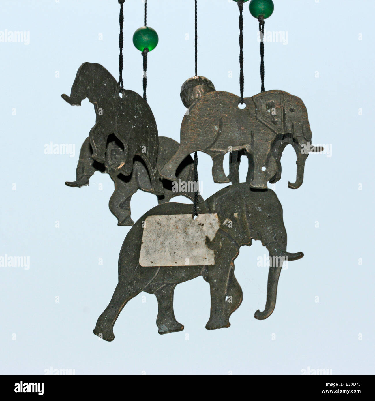 A wind chime of metal elephants - Stock Image