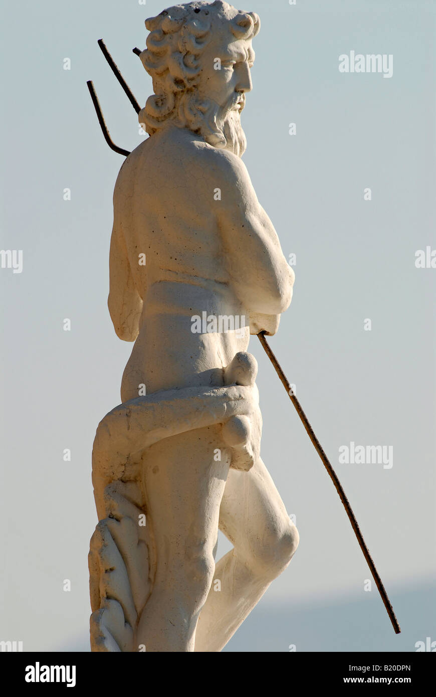 Statue with a replica of Poseidon/Neptune on a hill above Fangri (Fakri) Beach in the west of Samos island, Greece. - Stock Image