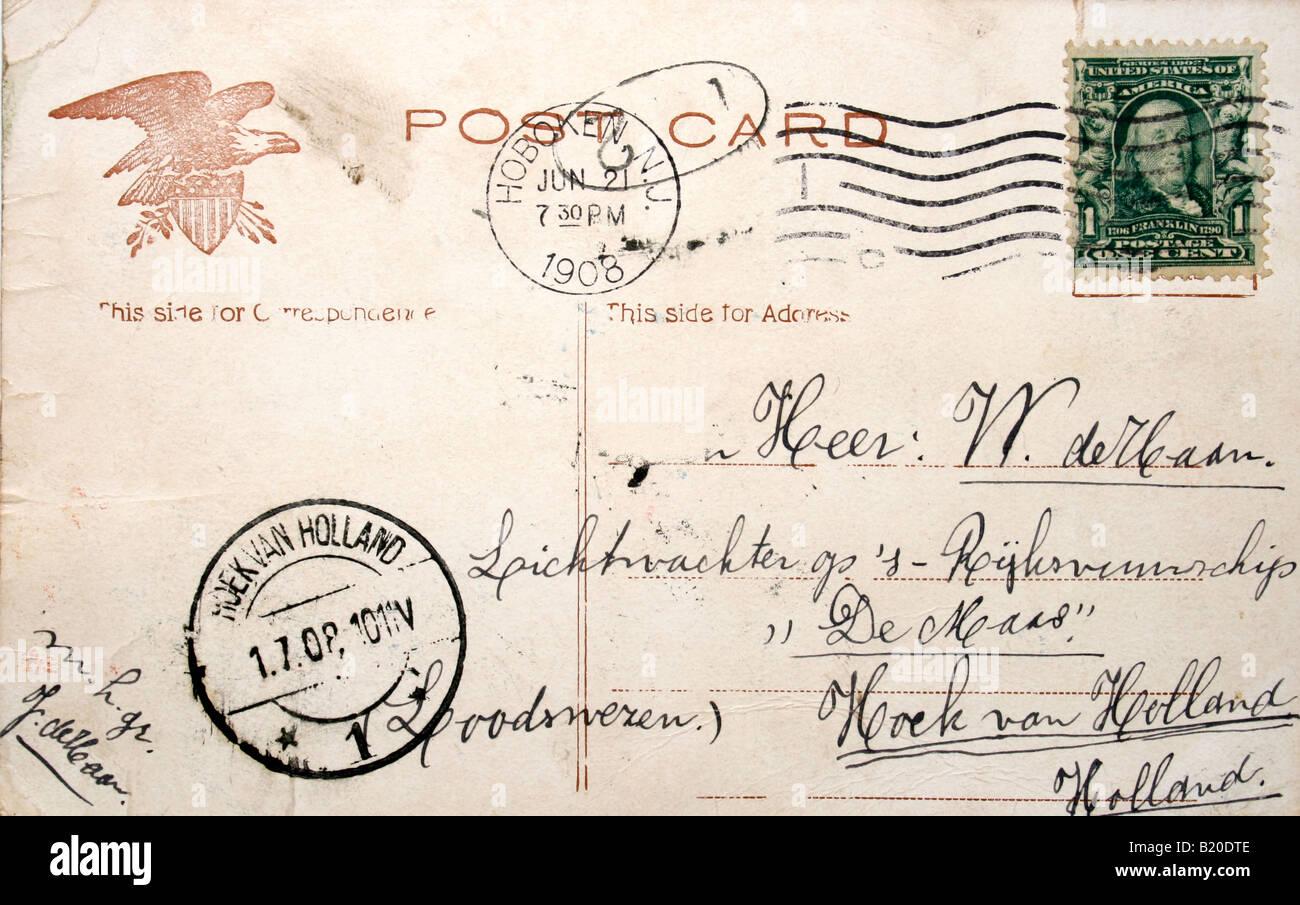 Backside of weathered vintage postcard of 1908 - Stock Image