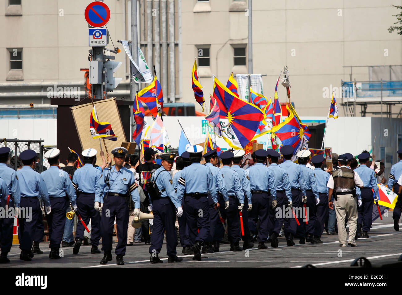 Heavily guarded Pro-Tibet demonstration during the G8 summit in Sapporo, Japan. Stock Photo