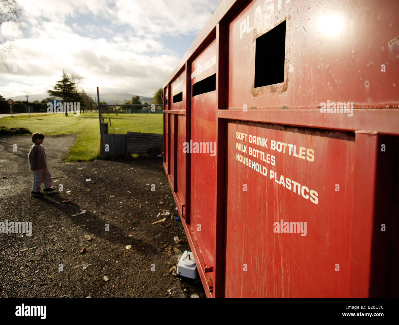 Boy aged six at recycling centre in Ashurst New Zealand - Stock Image