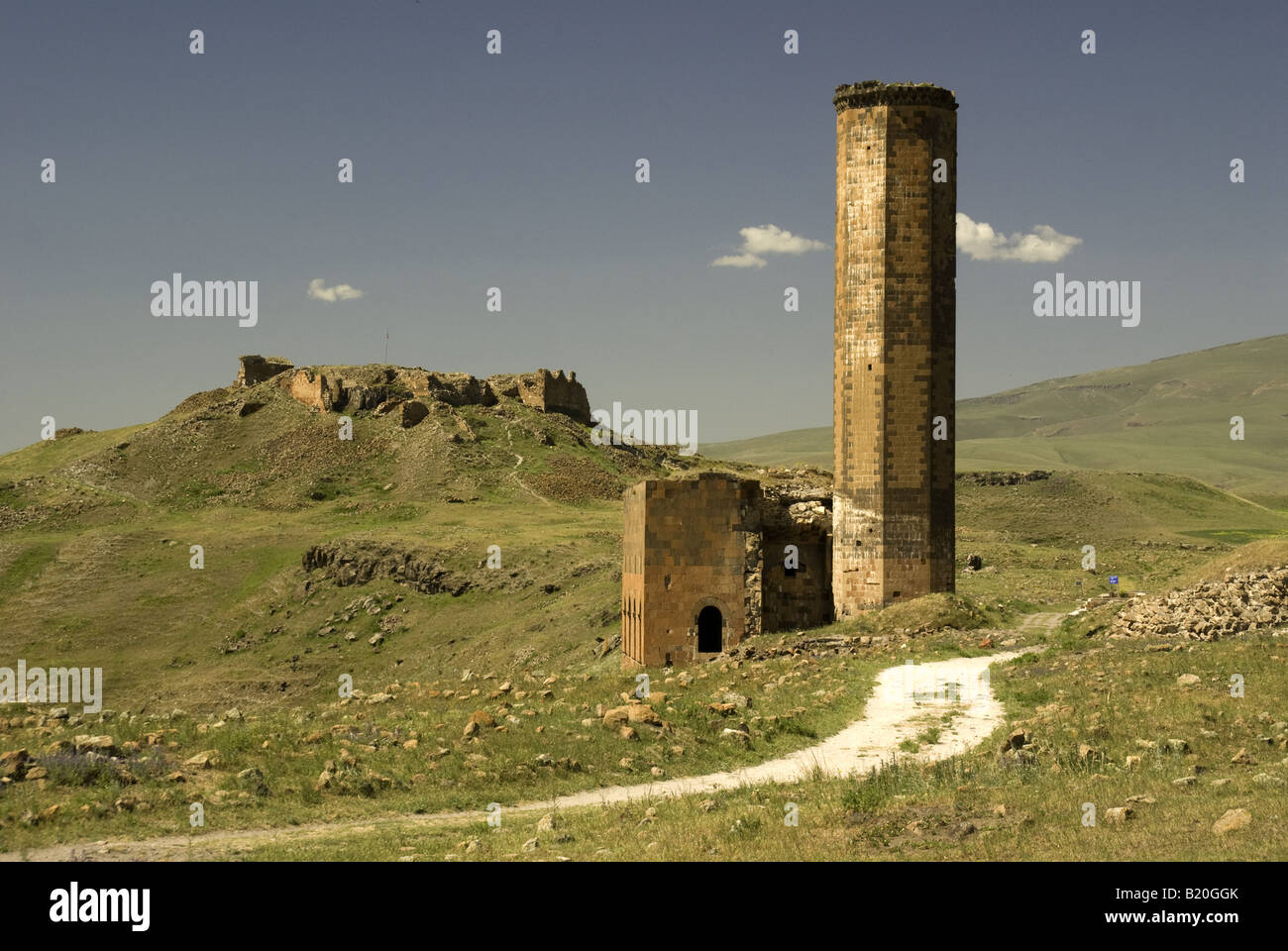 Remains of Menucehir Mosque, with Citadel behind, at Ani, ruined capital of Armenian Kingdom on border with Armenia - Stock Image