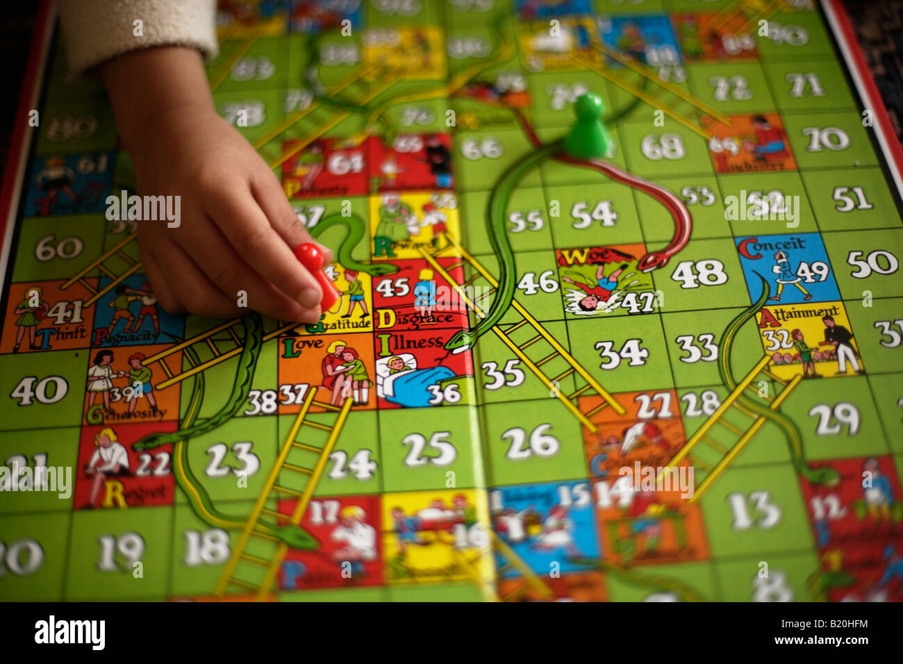 Children Play Game Of Snakes And Ladders Stock Photo Alamy