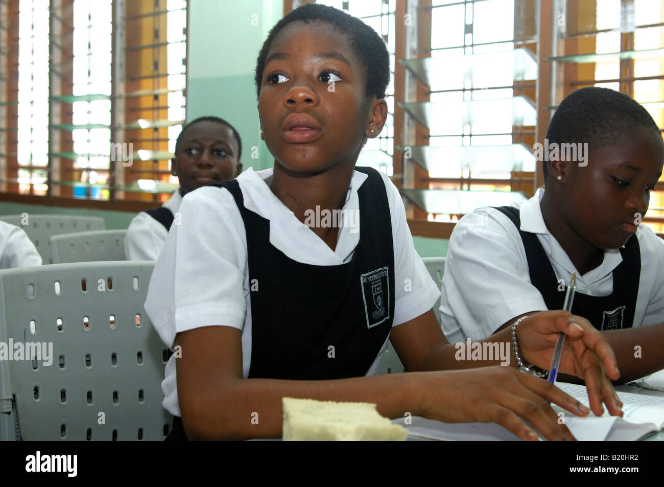 Attentive girl in a class of the De Youngsters International School Accra Ghana - Stock Image