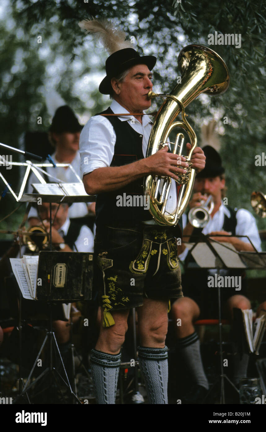 Man in lederhosen playing in a brass band in Bavaria Germany - Stock Image