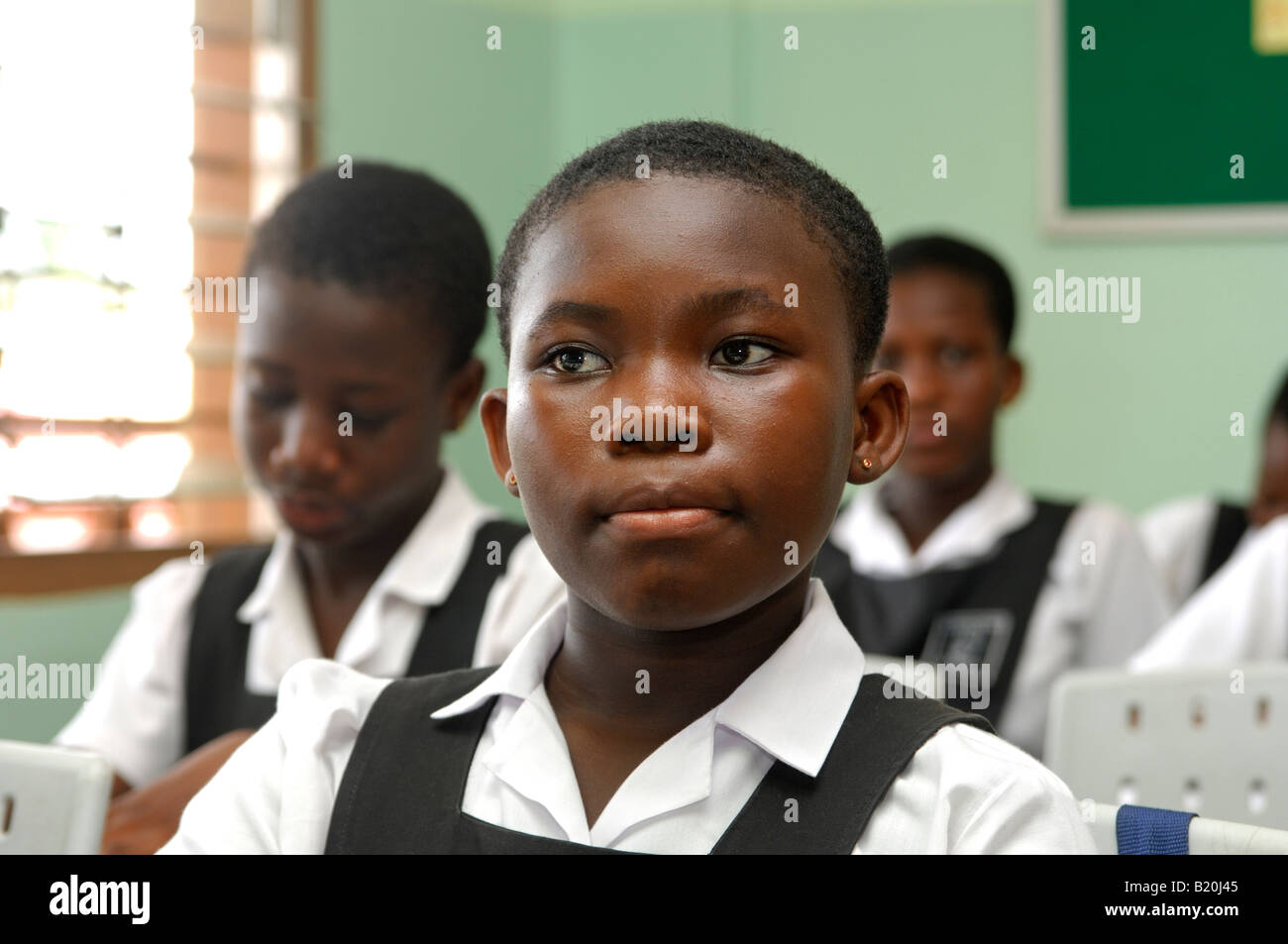 Attentive girl in a class of the De Youngsters International School, Accra, Ghana - Stock Image
