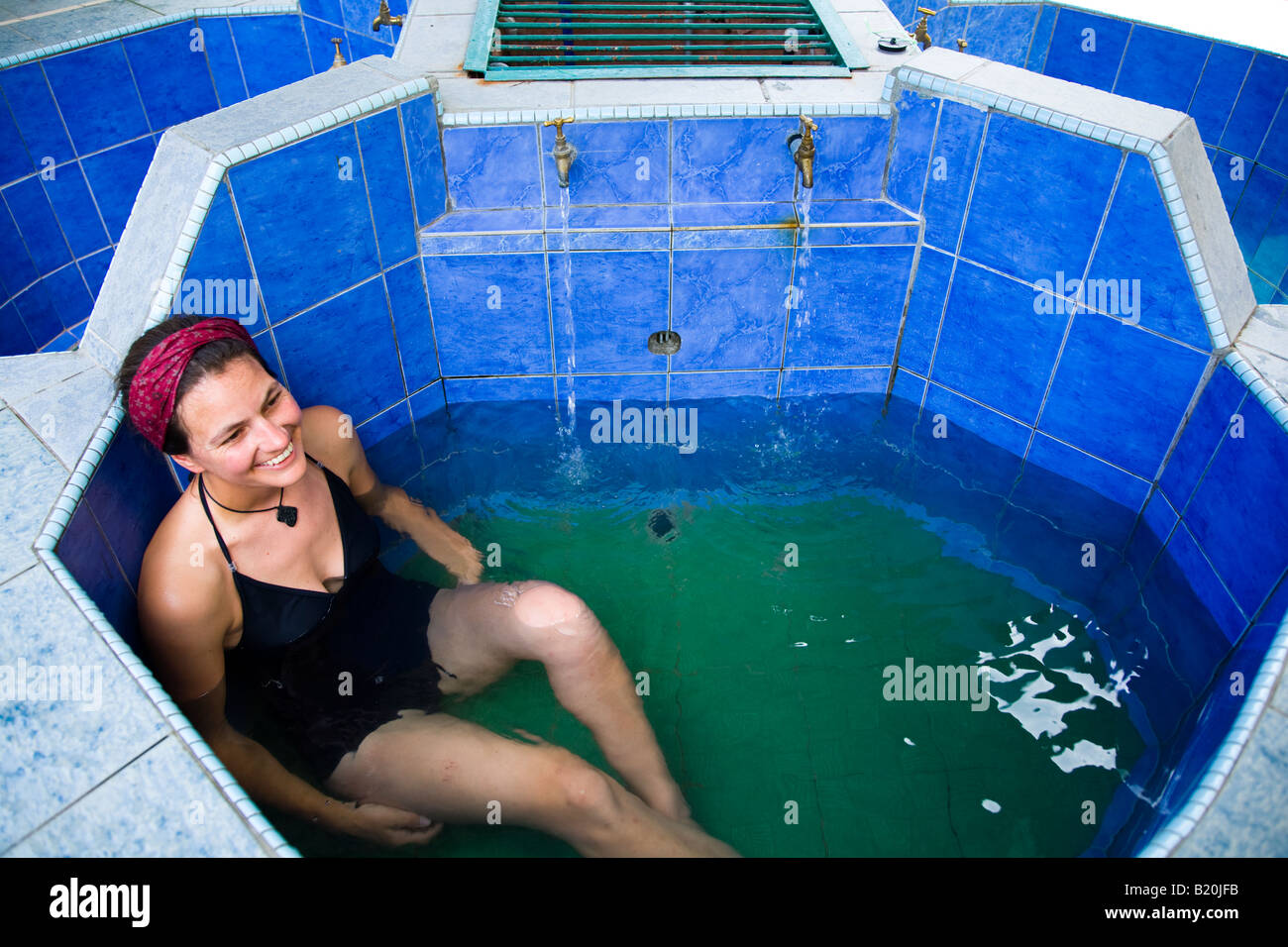 Sabah Malaysia Borneo Kinabalu National Park Woman in her late twenties relaxing in a japanese style hot tub - Stock Image