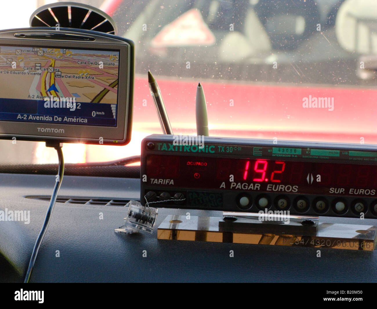 SPAIN Madrid Fare counter on dashboard of taxi cab price in Euros GPS system with streets of city - Stock Image