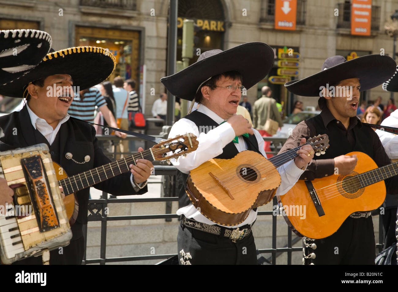 SPAIN Madrid Members of Mariachi band singing and playing guitars in