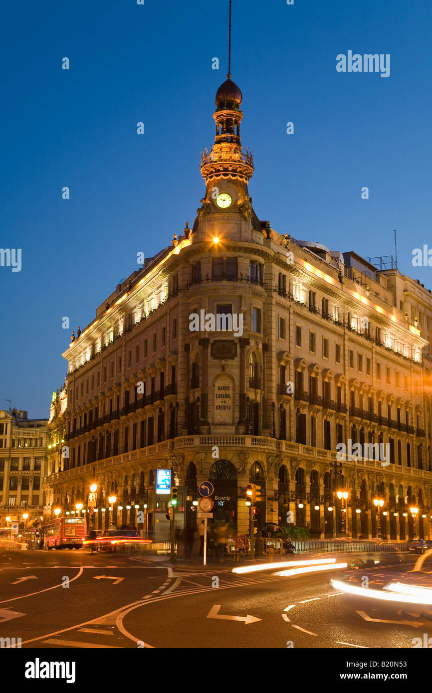 SPAIN Madrid Banco Espanol de Credito head office building at night with blurred motion of traffic - Stock Image