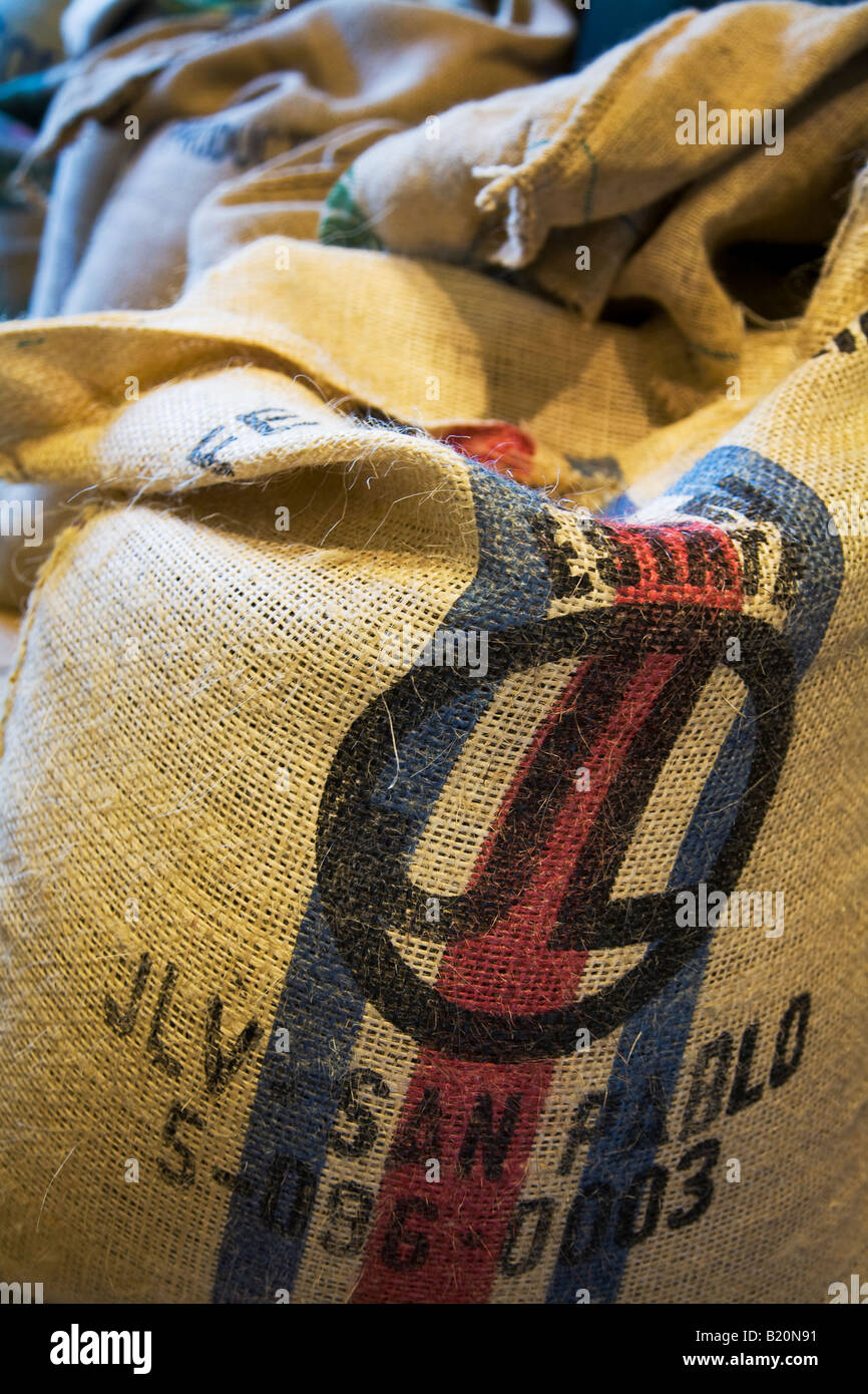 ILLINOIS Riverwoods Burlap bag with green coffee beans Name and origin stencil on side of sack - Stock Image