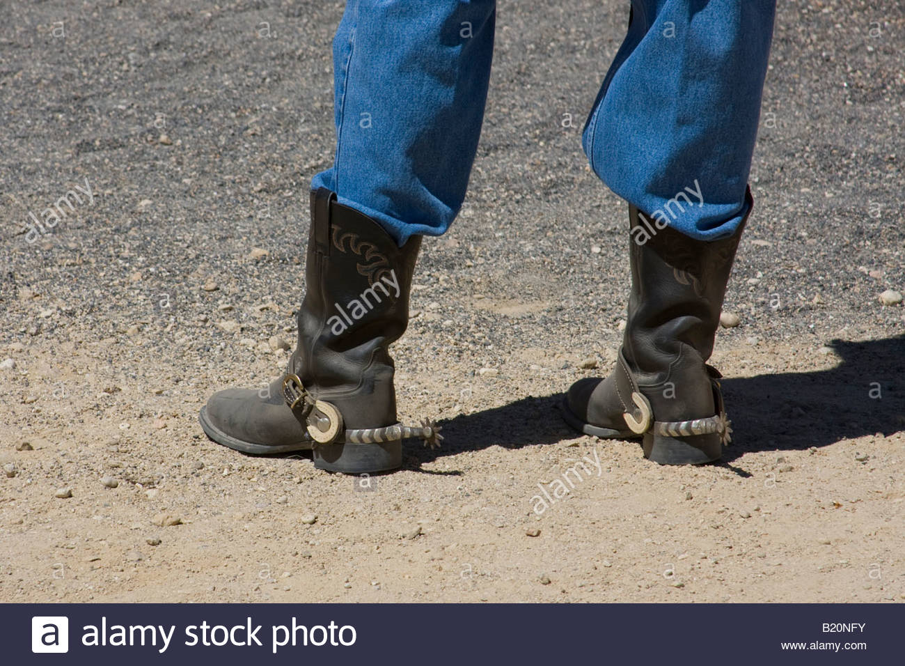 Black leather cowboy boots with spurs - Stock Image