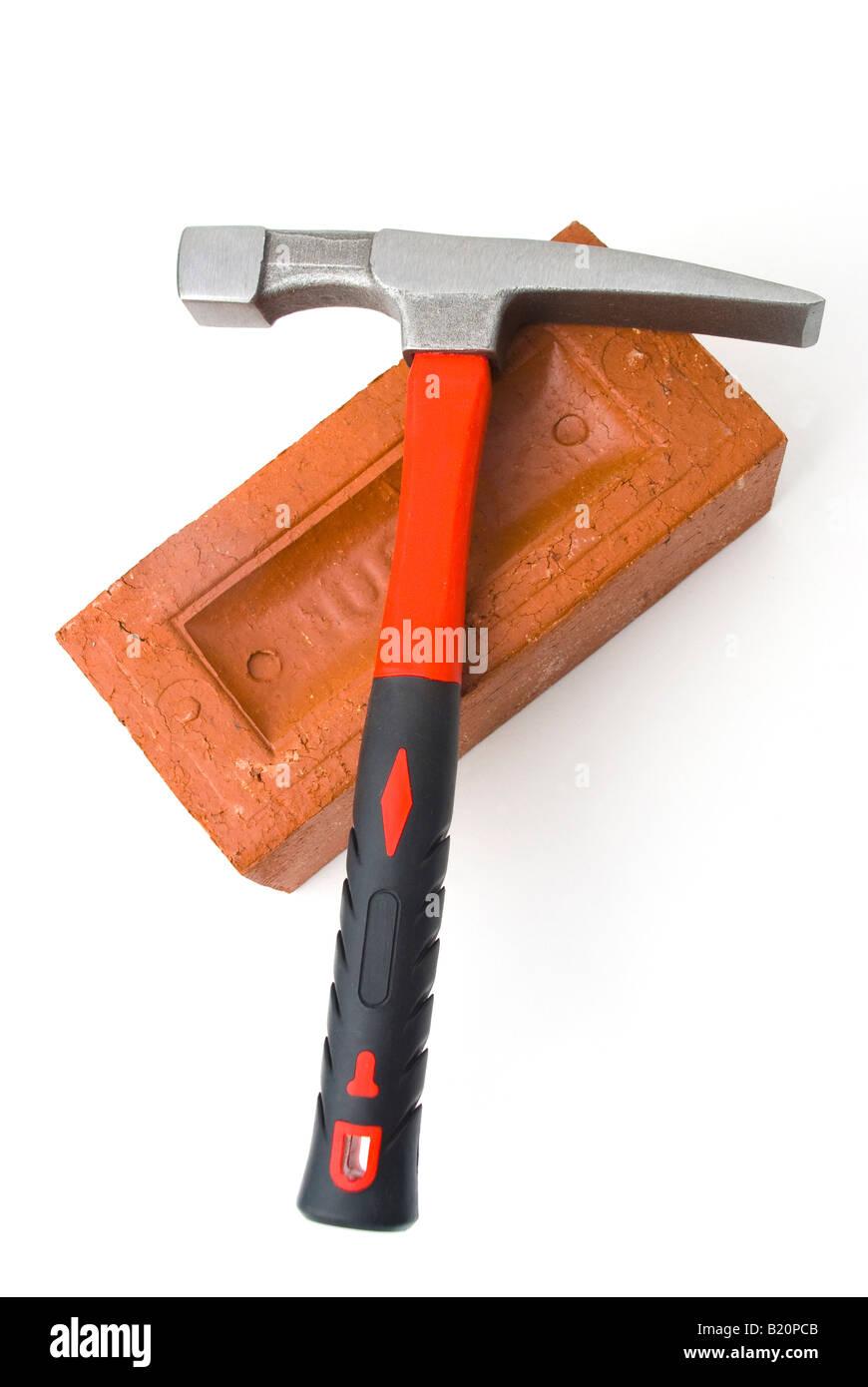 Brick hammer and brick Stock Photo