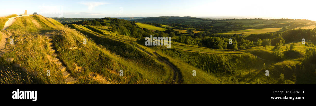 An evening panorama looking SW from the Cotswold scarp at Painswick Beacon, Gloucestershire - Stock Image