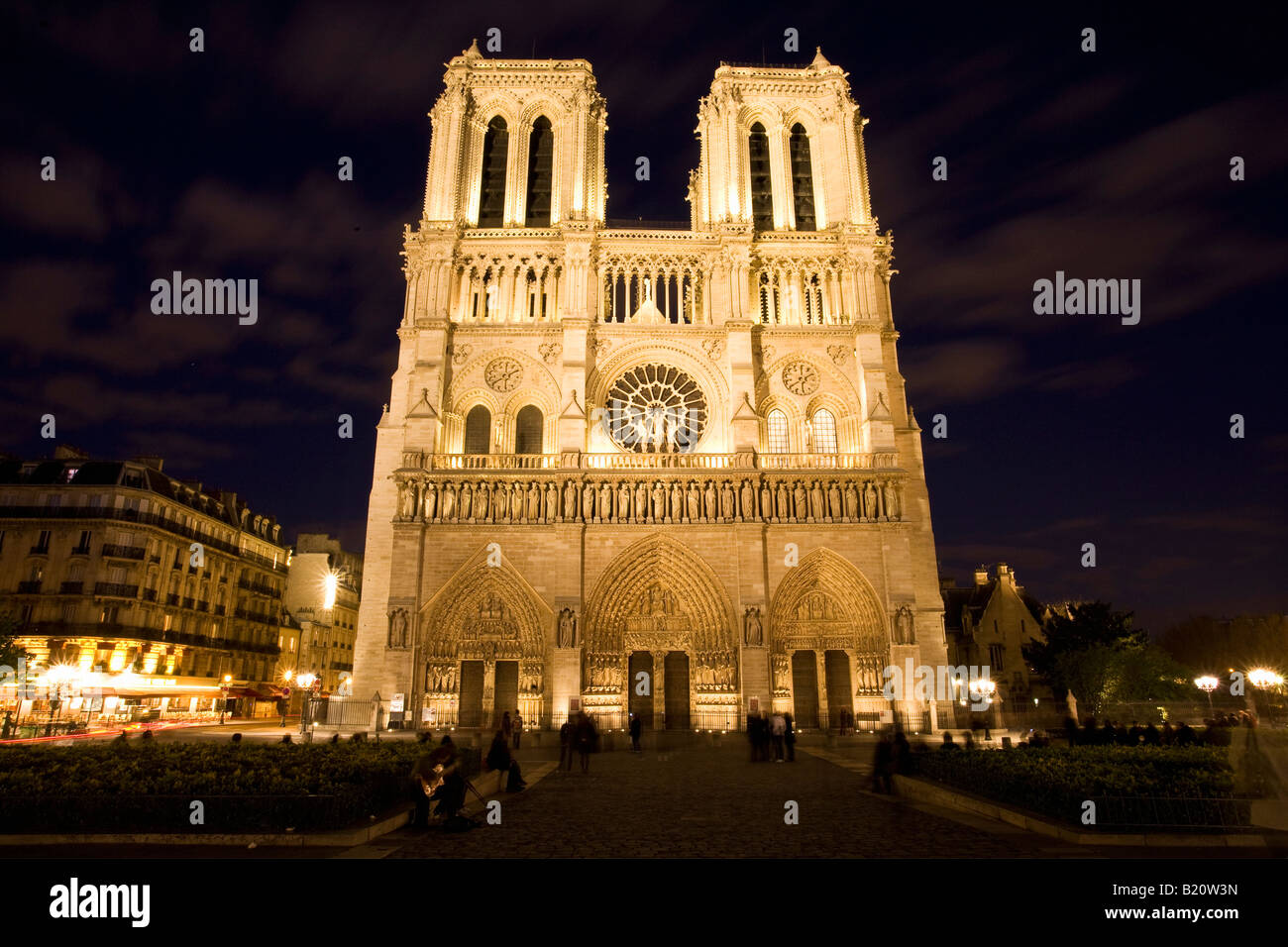 Notre Dame Cathedral floodlit illuminated illuminations in evening night light Paris France Europe - Stock Image