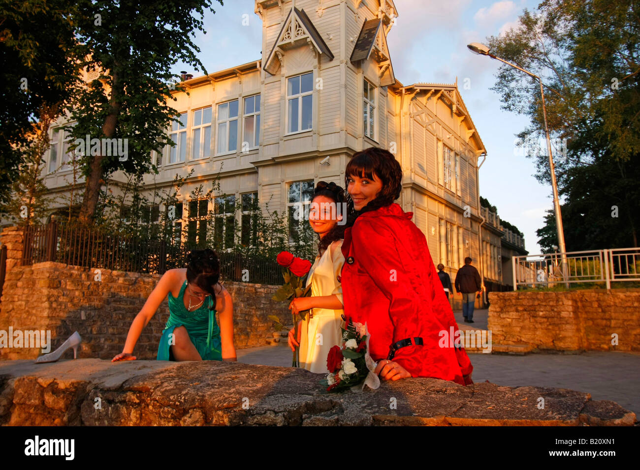 young girls ready for the night posing at the sea pavillon at the beach in Jurmala Latvia Baltic states - Stock Image