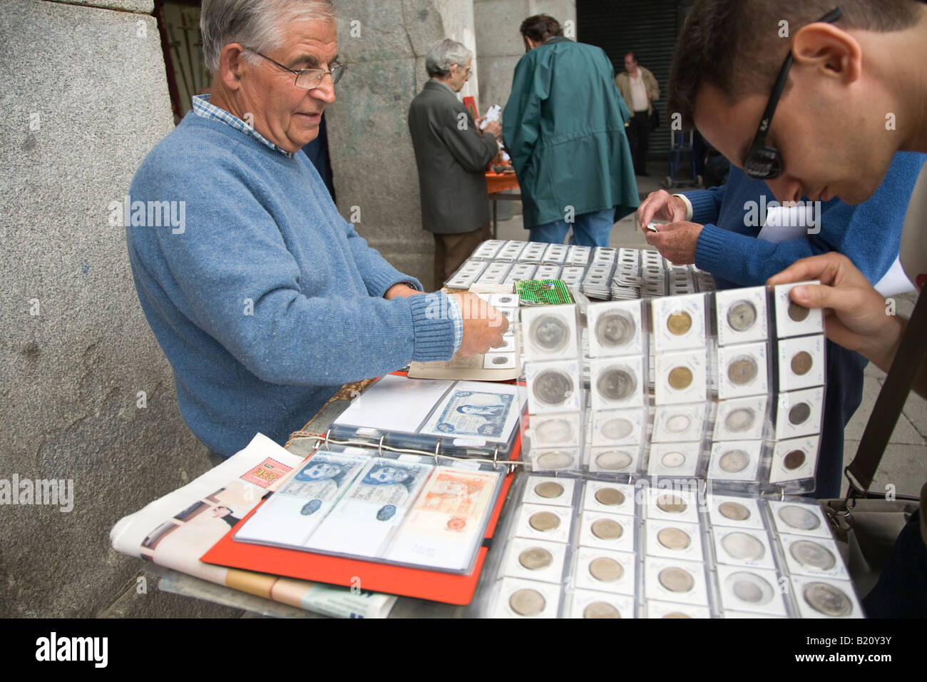 SPAIN Madrid Adult man display coin and currency collection for sale in Plaza Mayor on Sunday morning Collectors - Stock Image