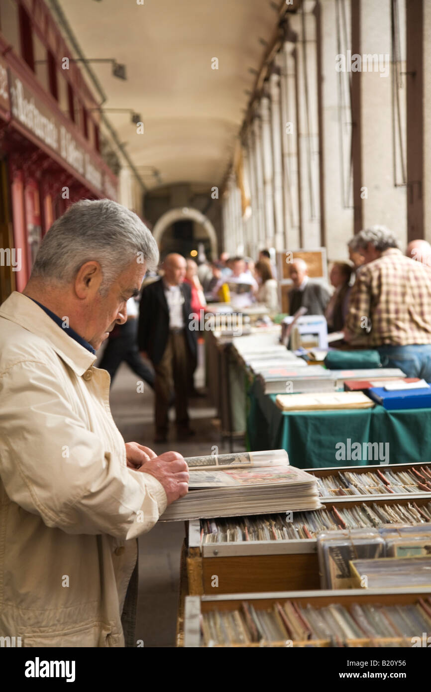 SPAIN Madrid Coin and currency collectors trade and sell collections in Plaza Mayor on Sunday morning Look through - Stock Image