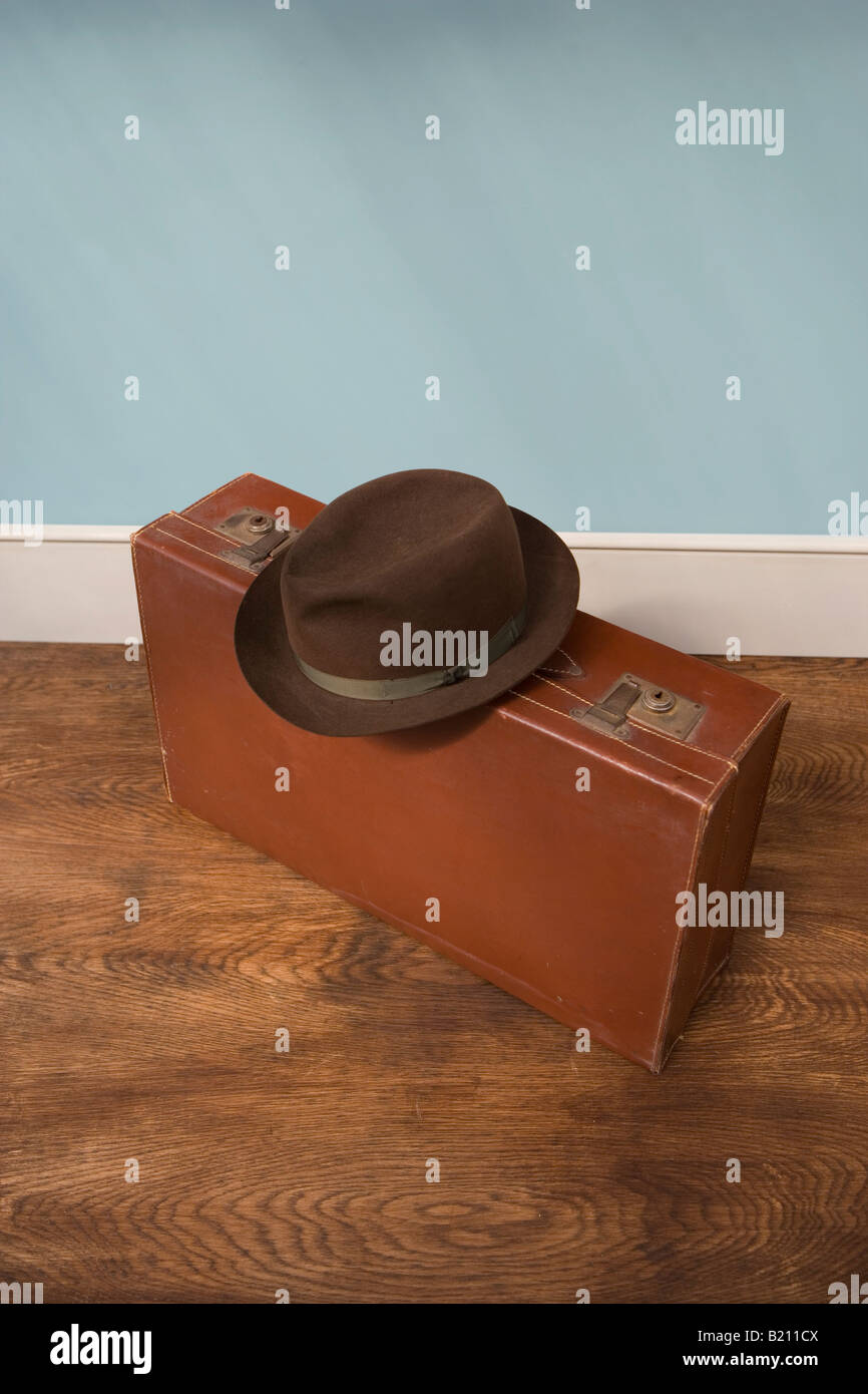 Vintage leather suitcase and mans Trilby hat - Stock Image