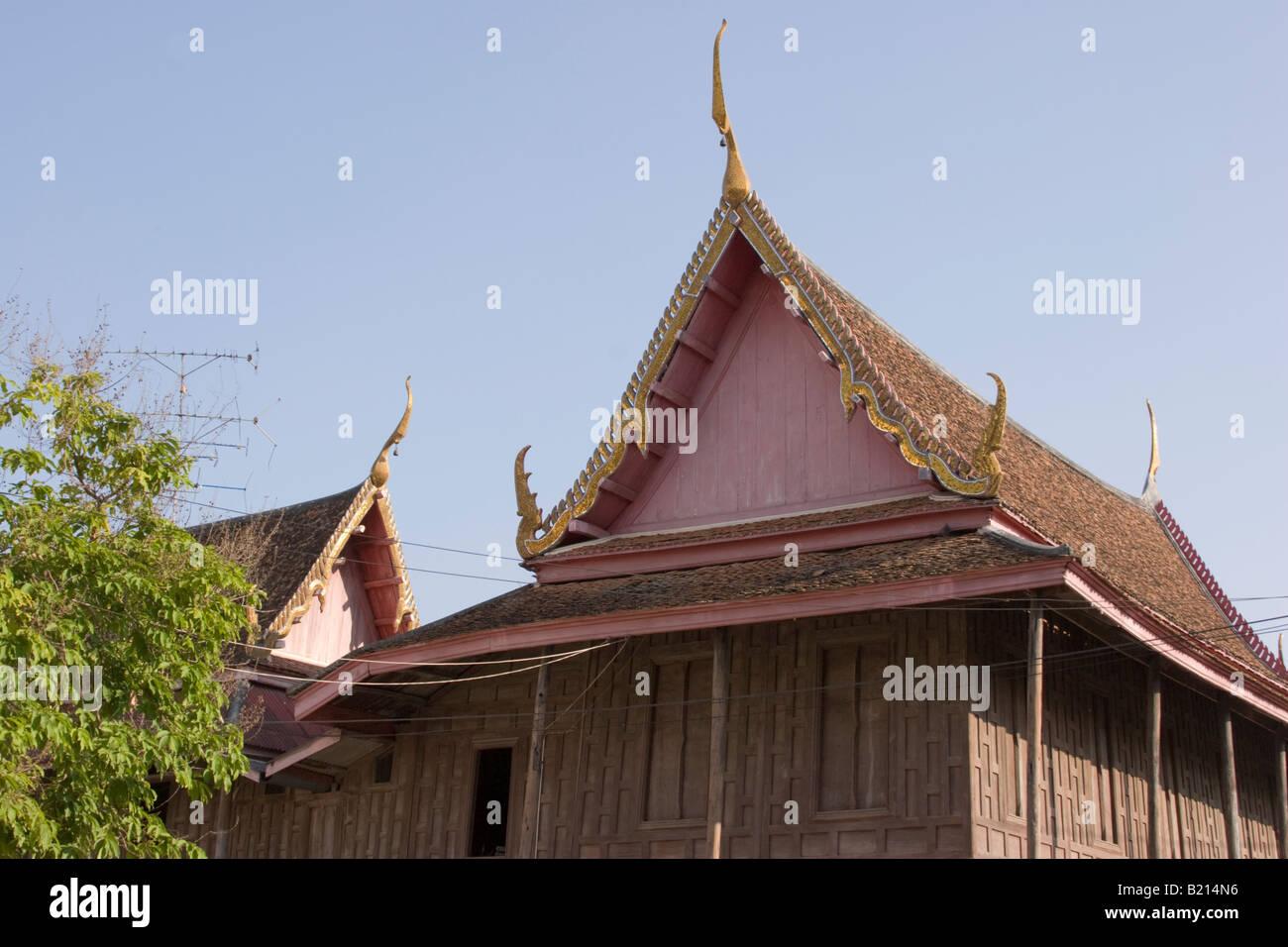 Traditional wooden Thai Buddhist temple Wat Yai Suwannaram, Phetchaburi, Thailand Stock Photo