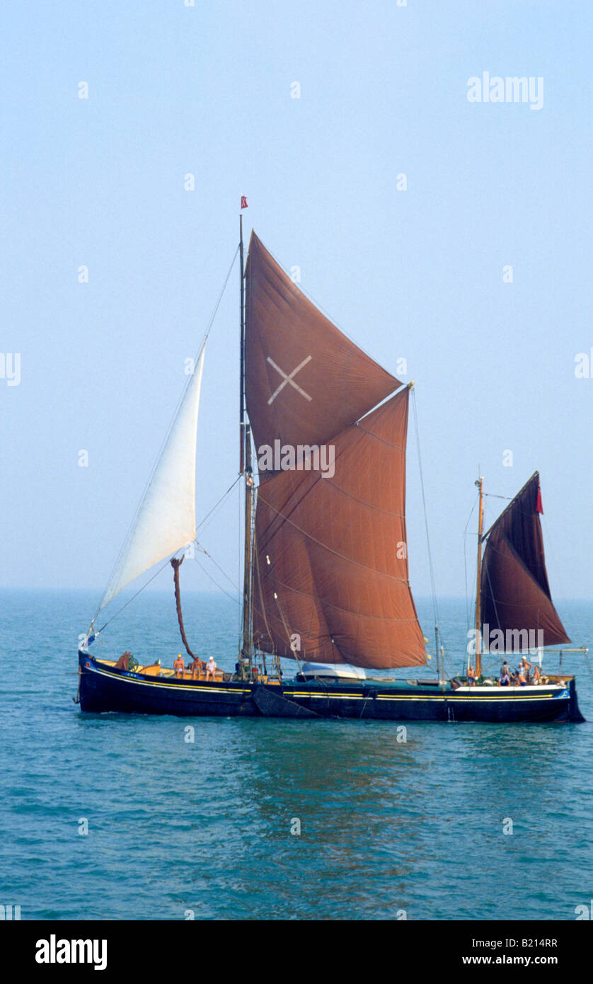 Thames Barge sailing vessel boat Essex coast England UK brown sails boat sailing Stock Photo
