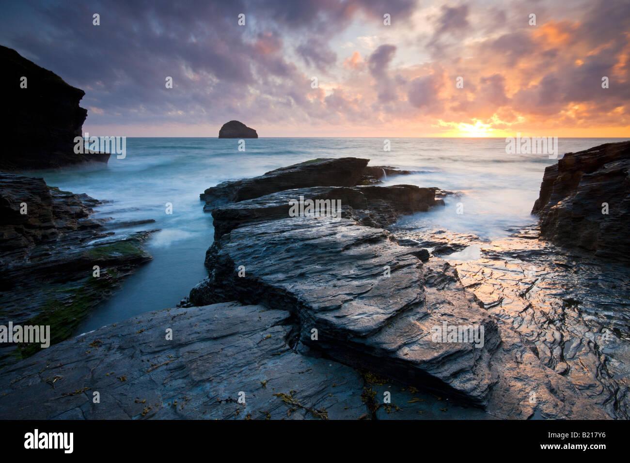 Trebarwith Strand and Gull Rock at sunset Cornwall England - Stock Image