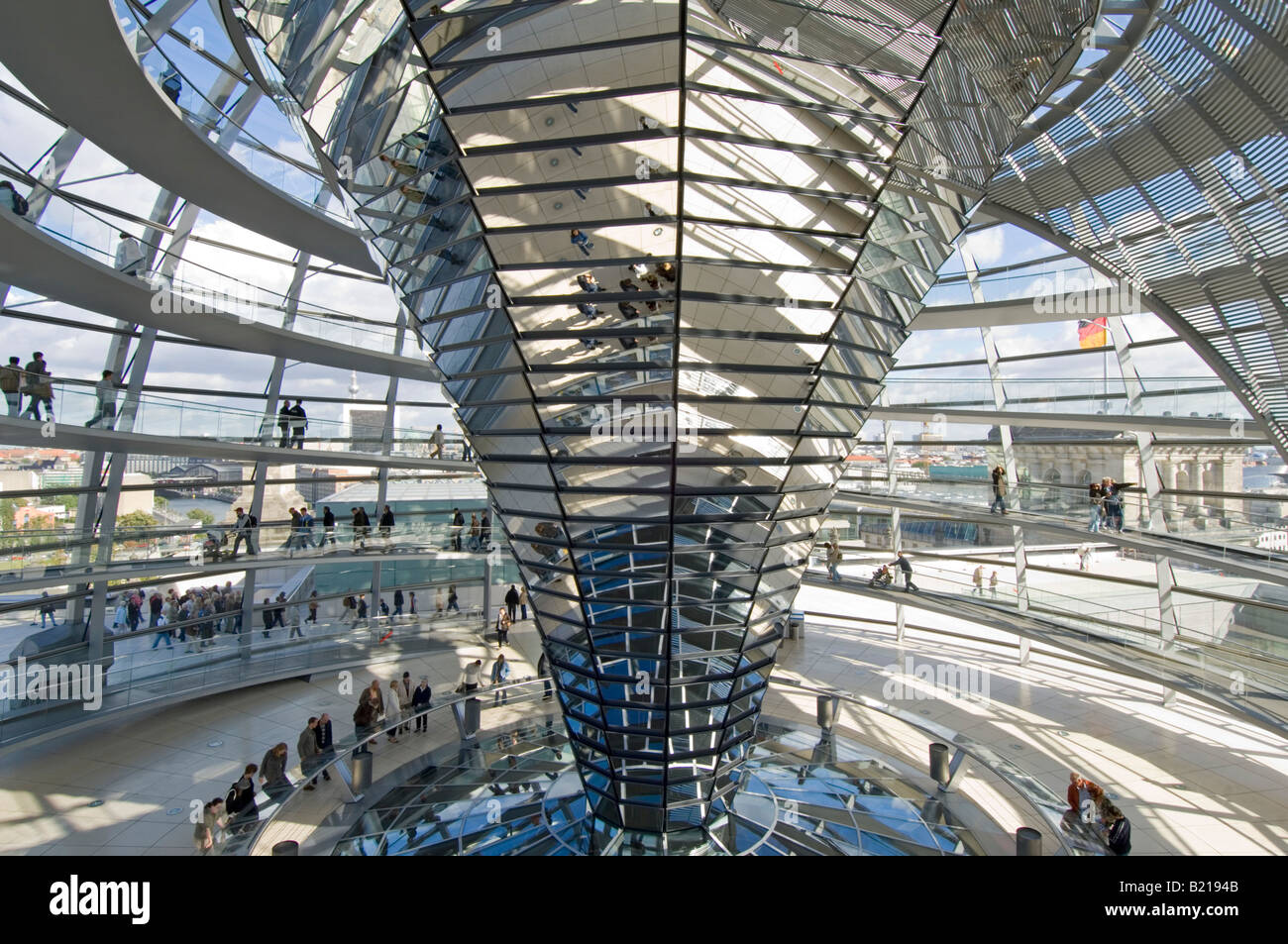 A wide angle view of tourists inside the dome on top of the Reichstag - the german parliment building. - Stock Image