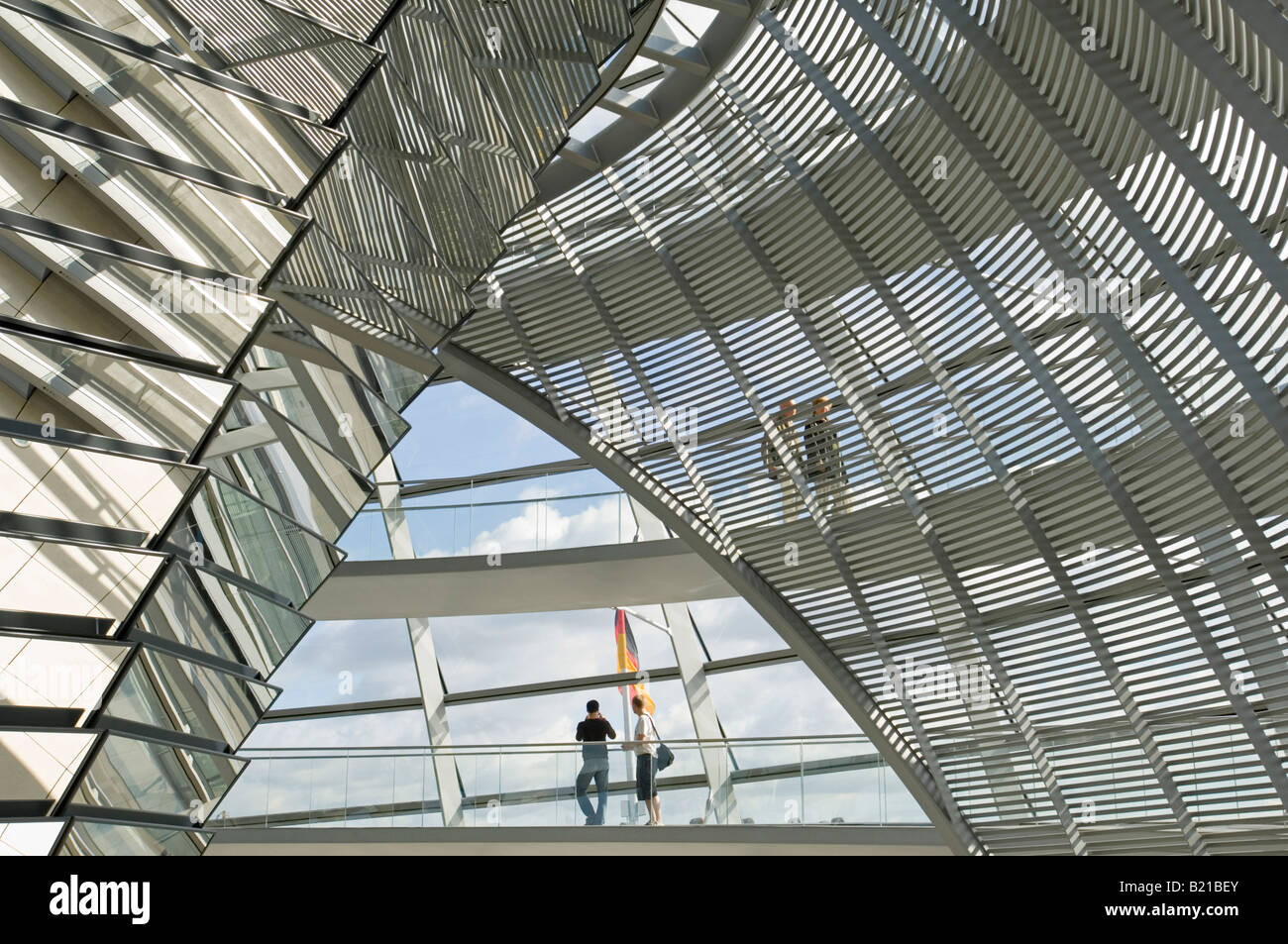 A view of tourists on the walkway inside the dome on top of the Reichstag - the german parliment building. - Stock Image