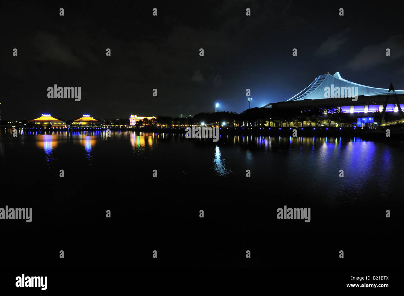 Singapore Indoor Stadium and Kallang river at night - Stock Image