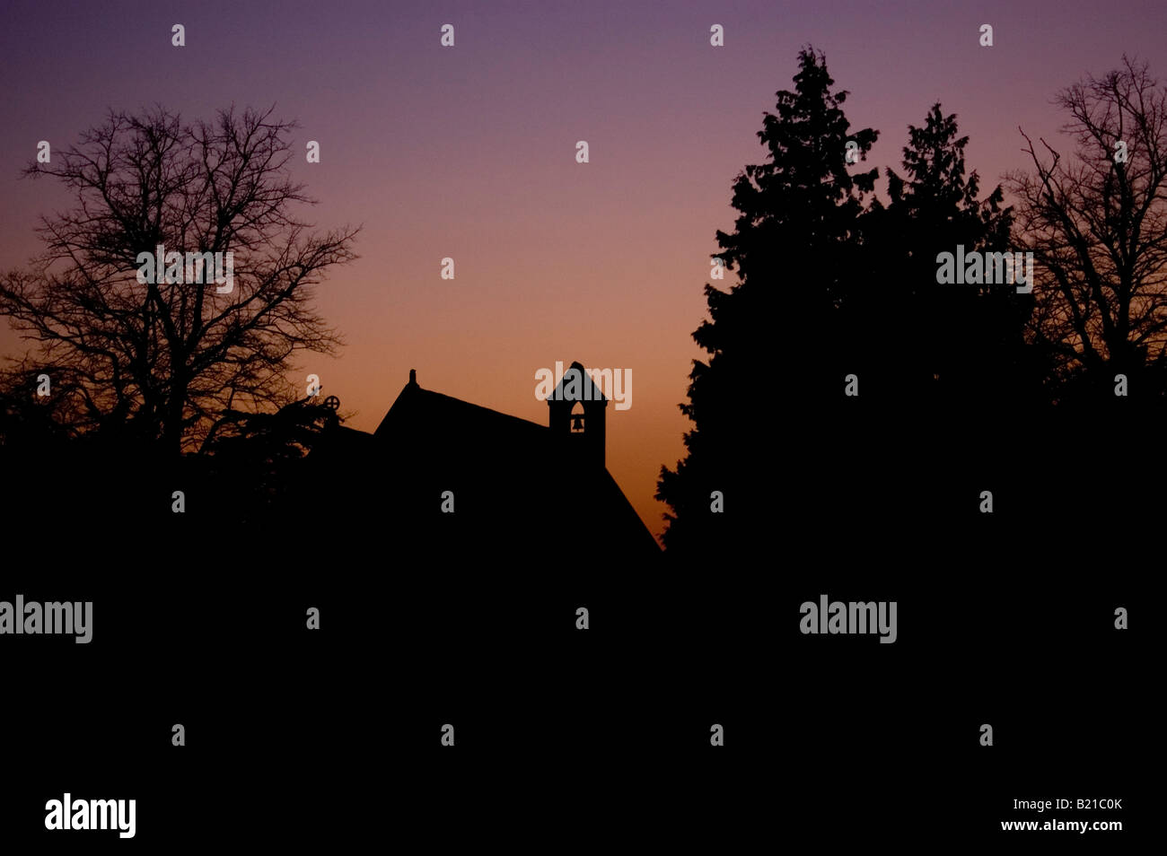 Sunset church sillouette trees - Stock Image