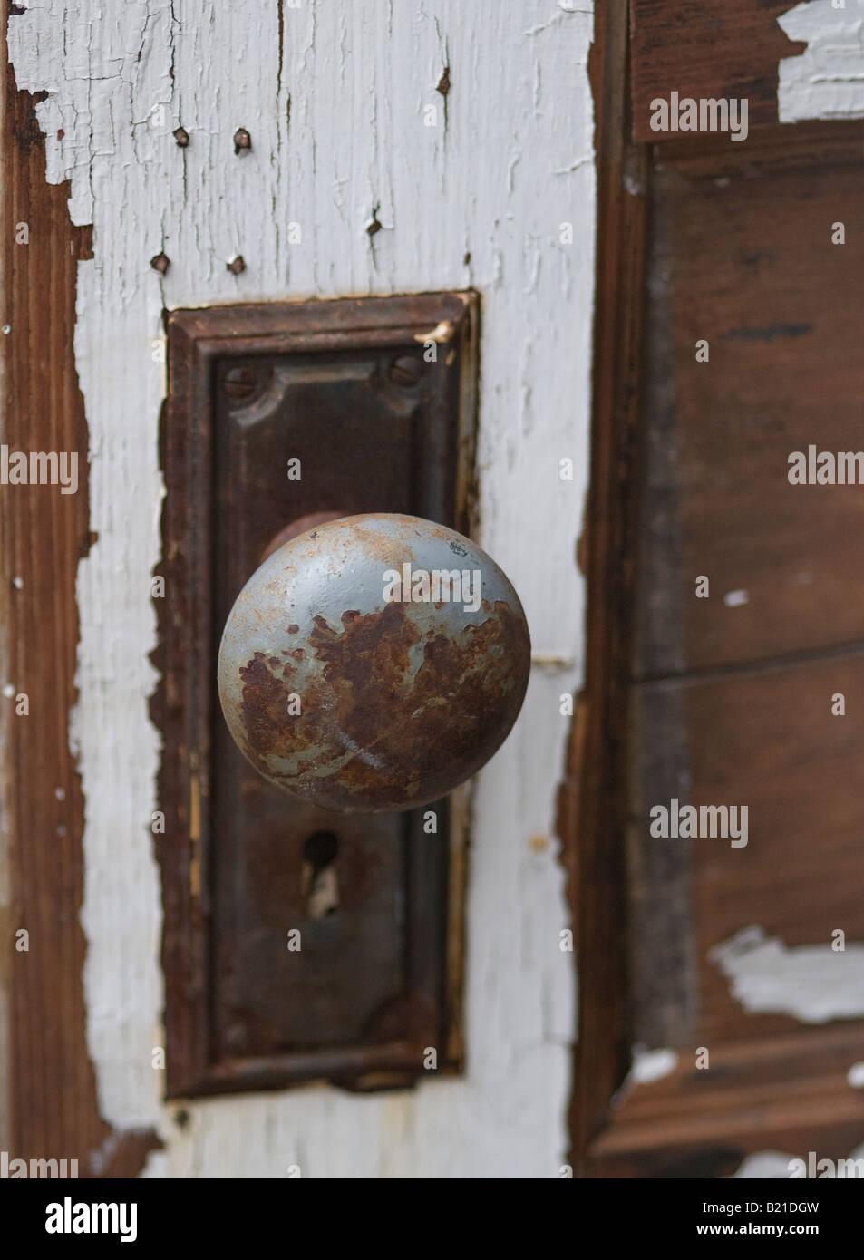 Old fashioned antique doorknob on wooden door - Stock Image