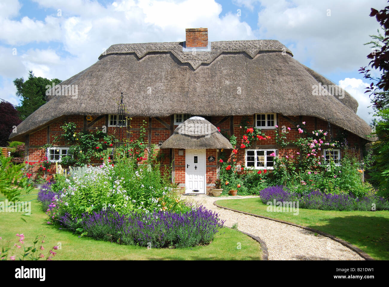 Thatched country cottage and garden, Itchen Stoke, Hampshire, England, United Kingdom - Stock Image