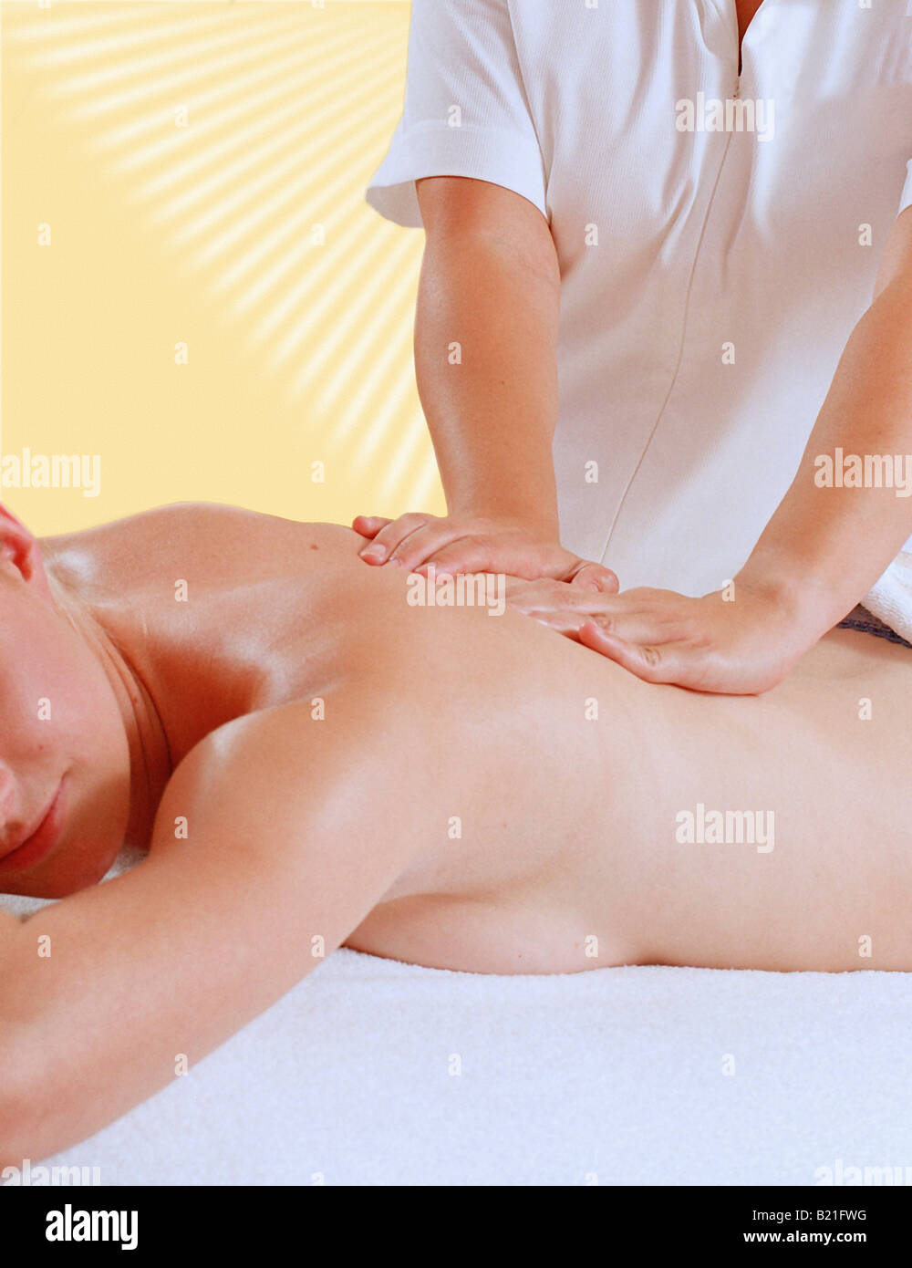 MASSEUSE AND CLIENT AT A HEALTH SPAR - Stock Image