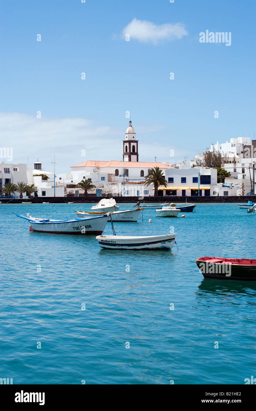 the church 'Iglesia de San Gines' at the lagoon 'Charco de San Gines' with fisher boats, Arrecife, - Stock Image