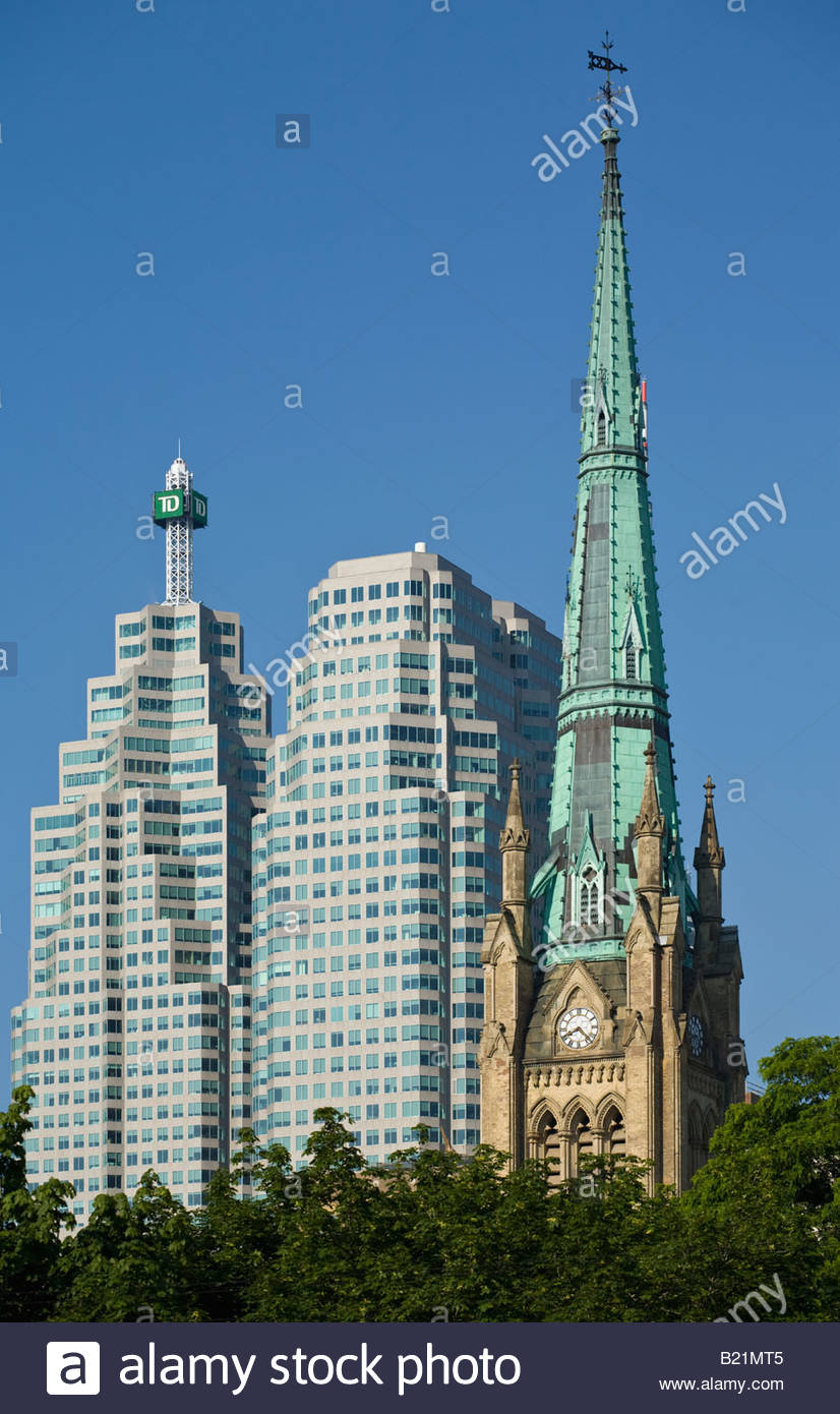 Saint James Cathedral and Brookfield Place skyscrapers Business and church part of history of Toronto Ontario Canada - Stock Image