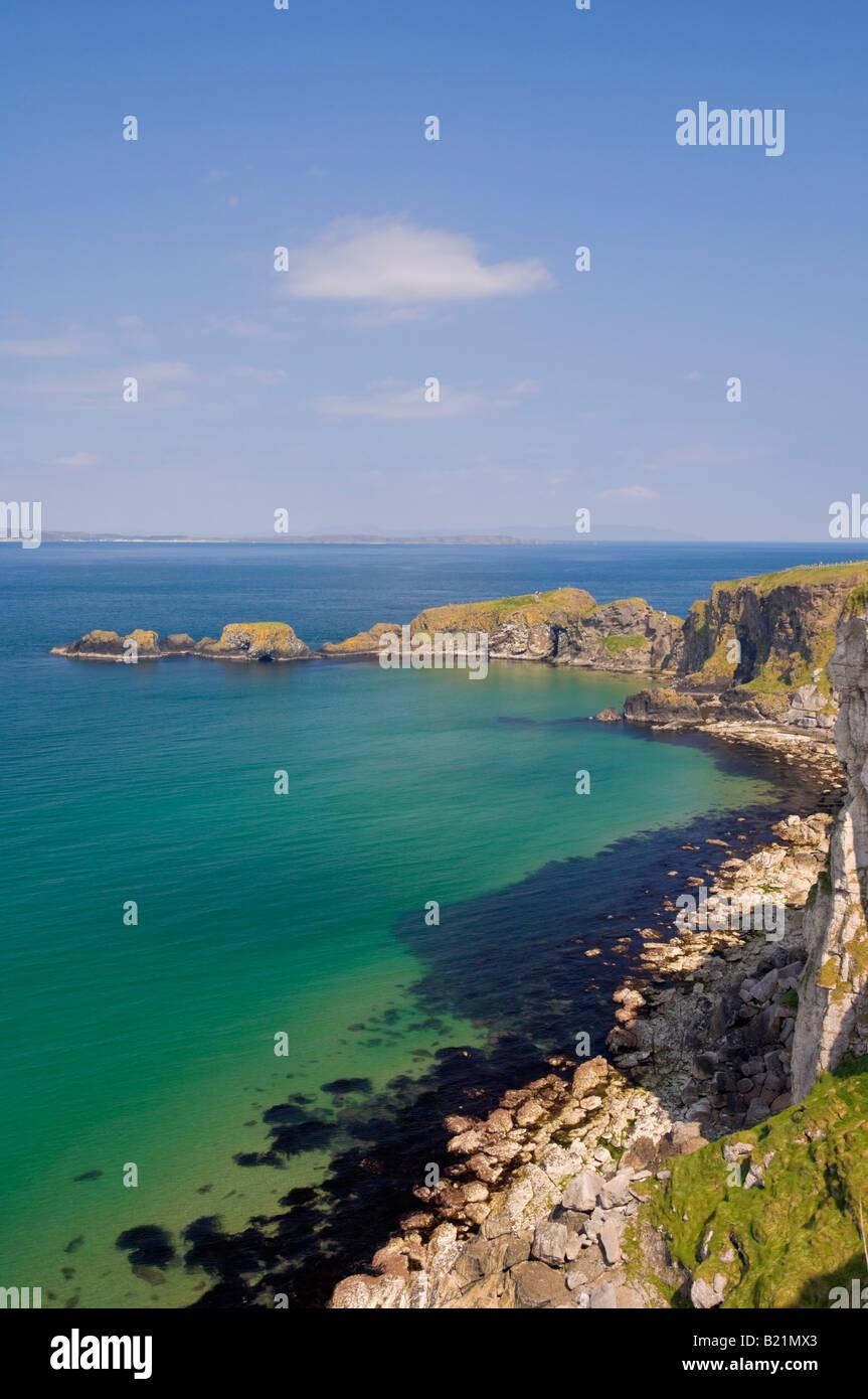 Carrick island in Larrybane bay North Antrim causeway coast way County Antrim Northern Ireland GB UK EU Europe - Stock Image
