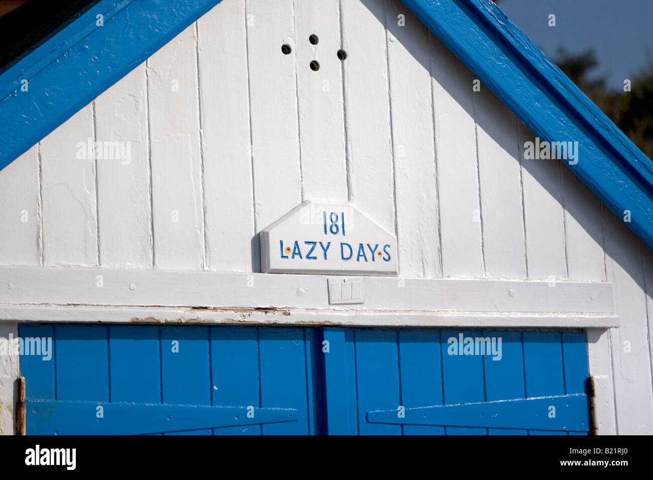 'Lazy Days.' Blue and white beach hut in Felixstowe, Suffolk, England. - Stock Image