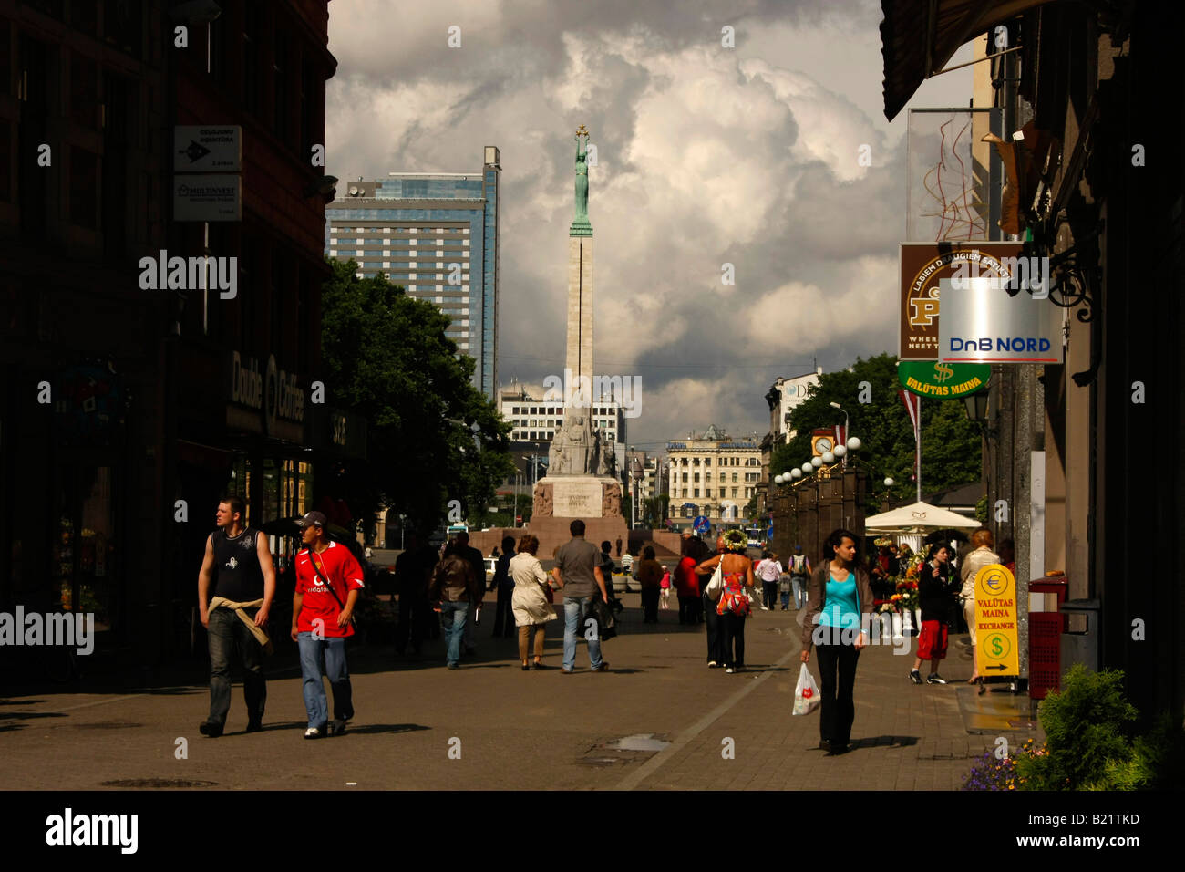 pedestrian area and Freedom Monument in Riga Latvia Baltic States - Stock Image