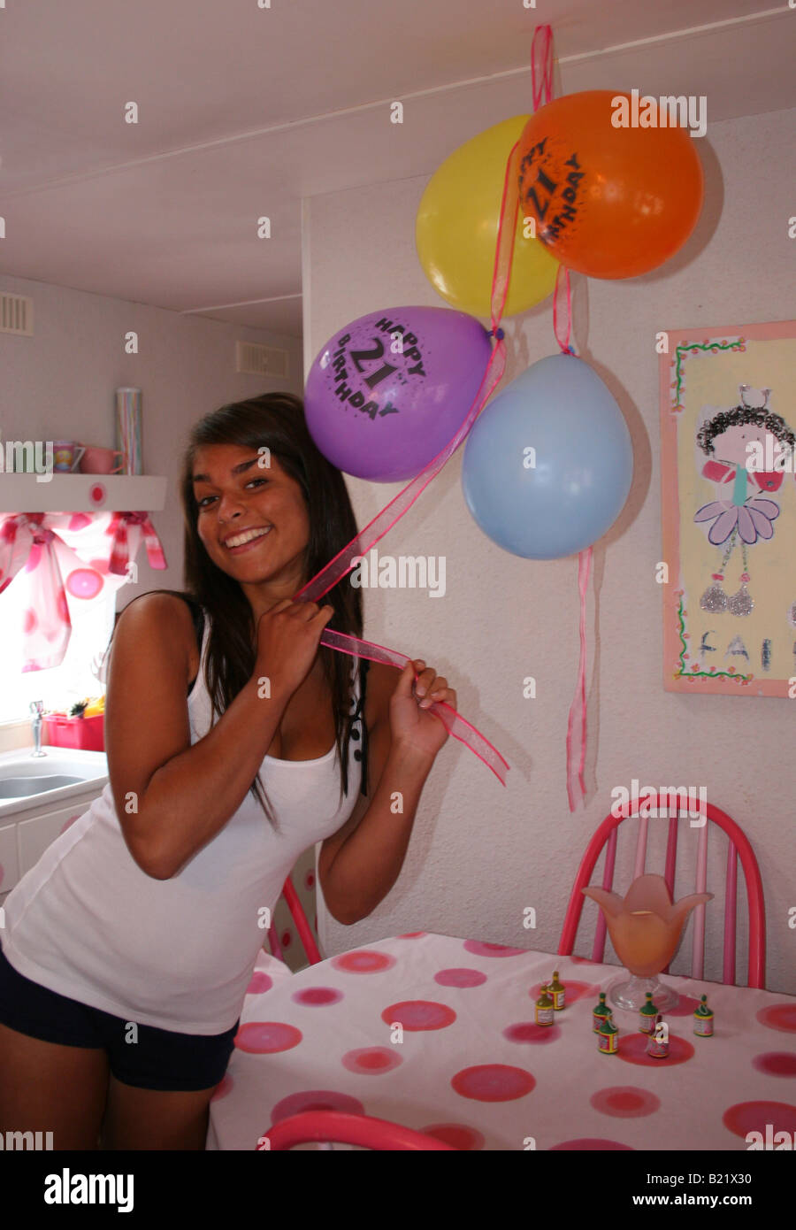 young woman celebrating her 21st birthday - Stock Image