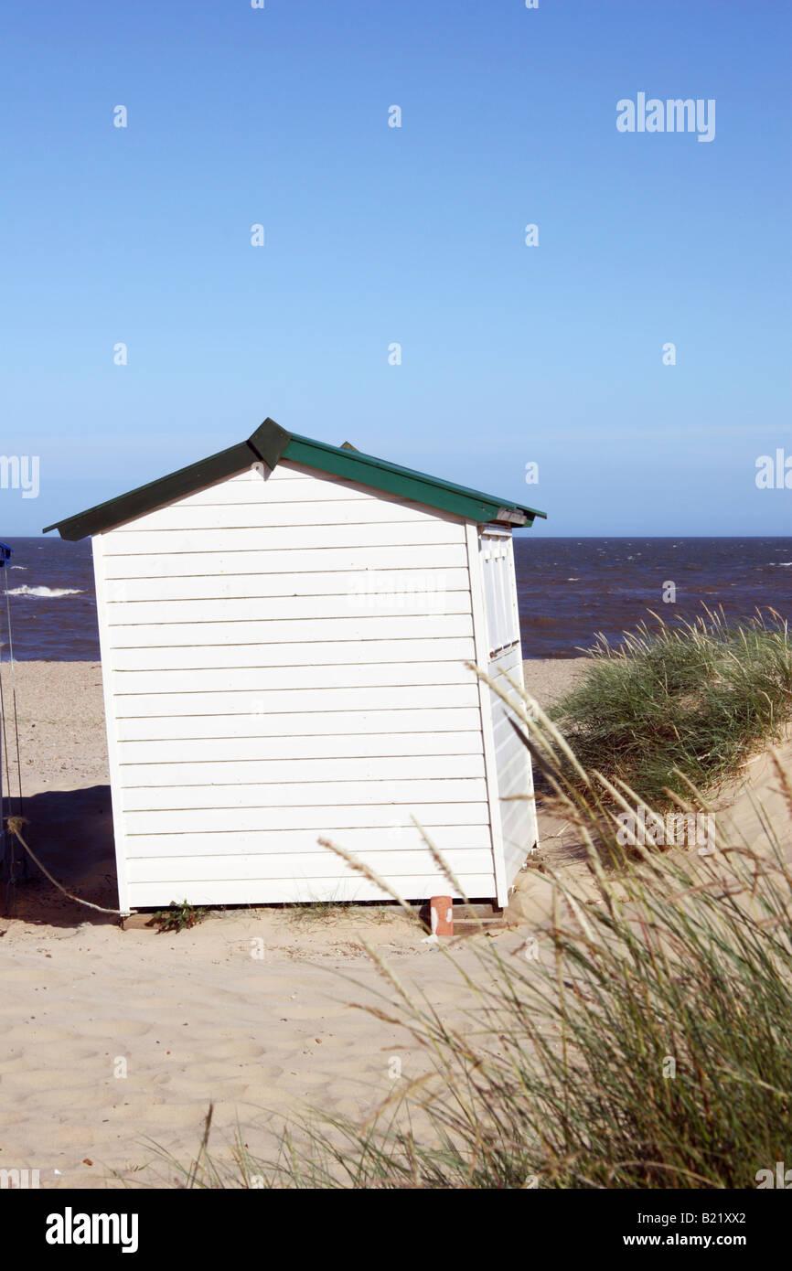 Quaint wooden beach hut. on Southwold beach in Suffolk, England. - Stock Image