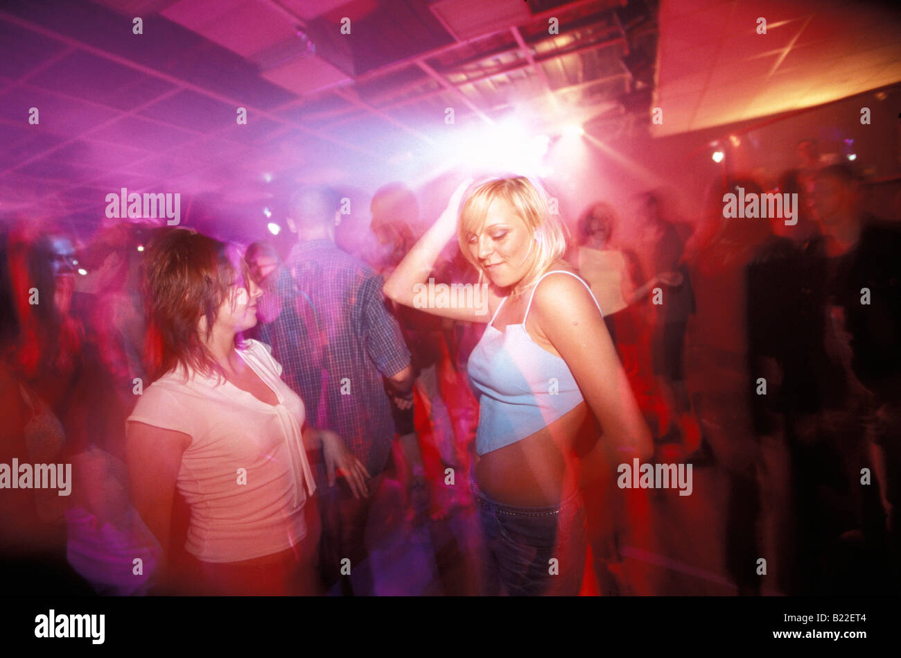 Two young girls dancing in Park Disco Club Warsaw Poland Stock Photo