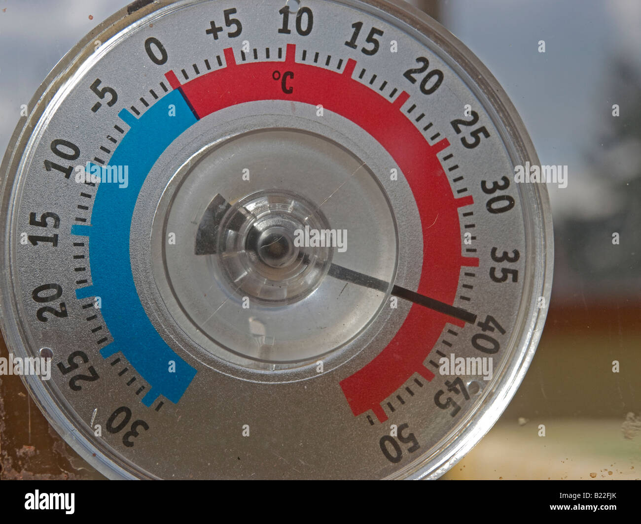 thermometer showing high temperature very hot summer climate change dangerous heat - Stock Image