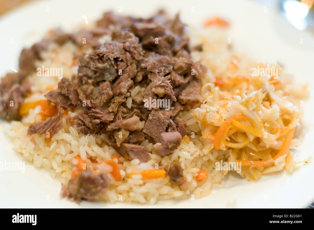 plate of pilaf or plov rice with meat kazakhstan stock photo
