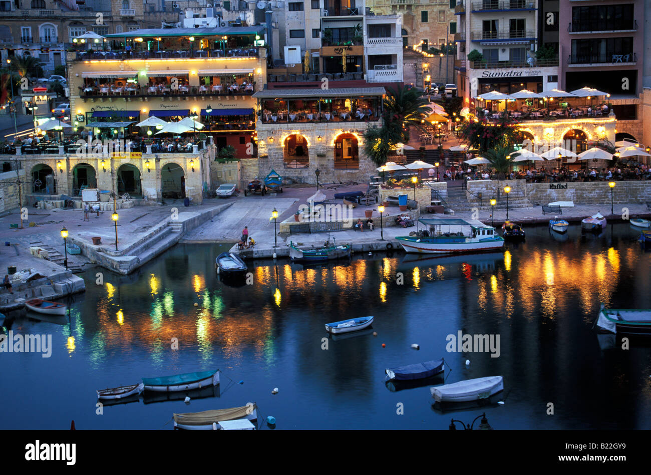 Restaurants And Harbour At Night Spinola Bay St Julian S Malta Stock