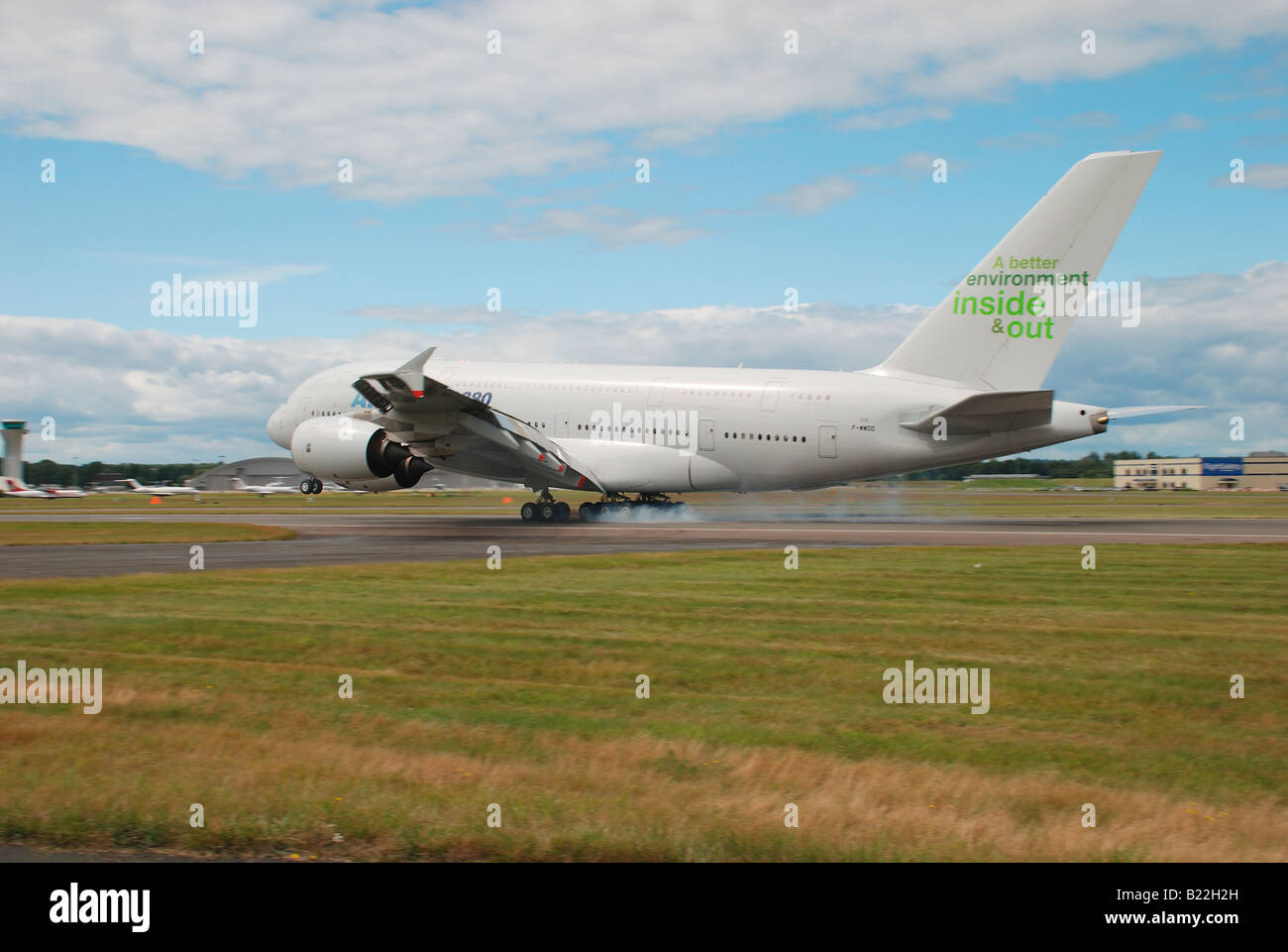 airbus industries A380 landing at farnborough 2008 with smoke coming from the tyres on touch down Stock Photo